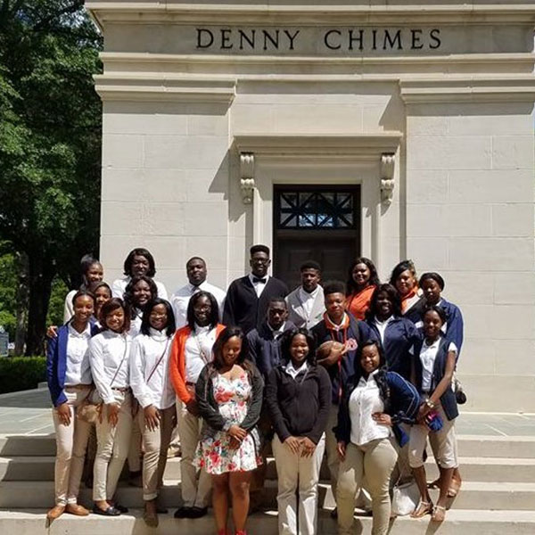 Group photo in front of Denny Chimes
