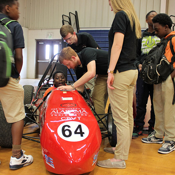 Students working on a race car.