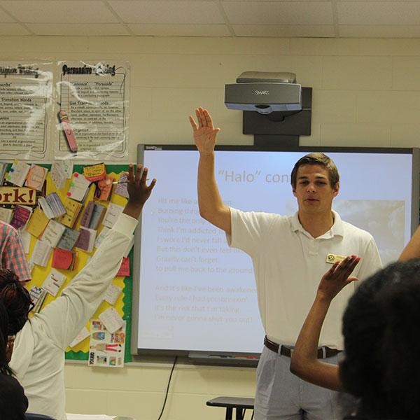 UA students in a school classroom teaching.