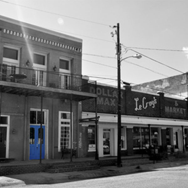 A black and white photo of older buildings.
