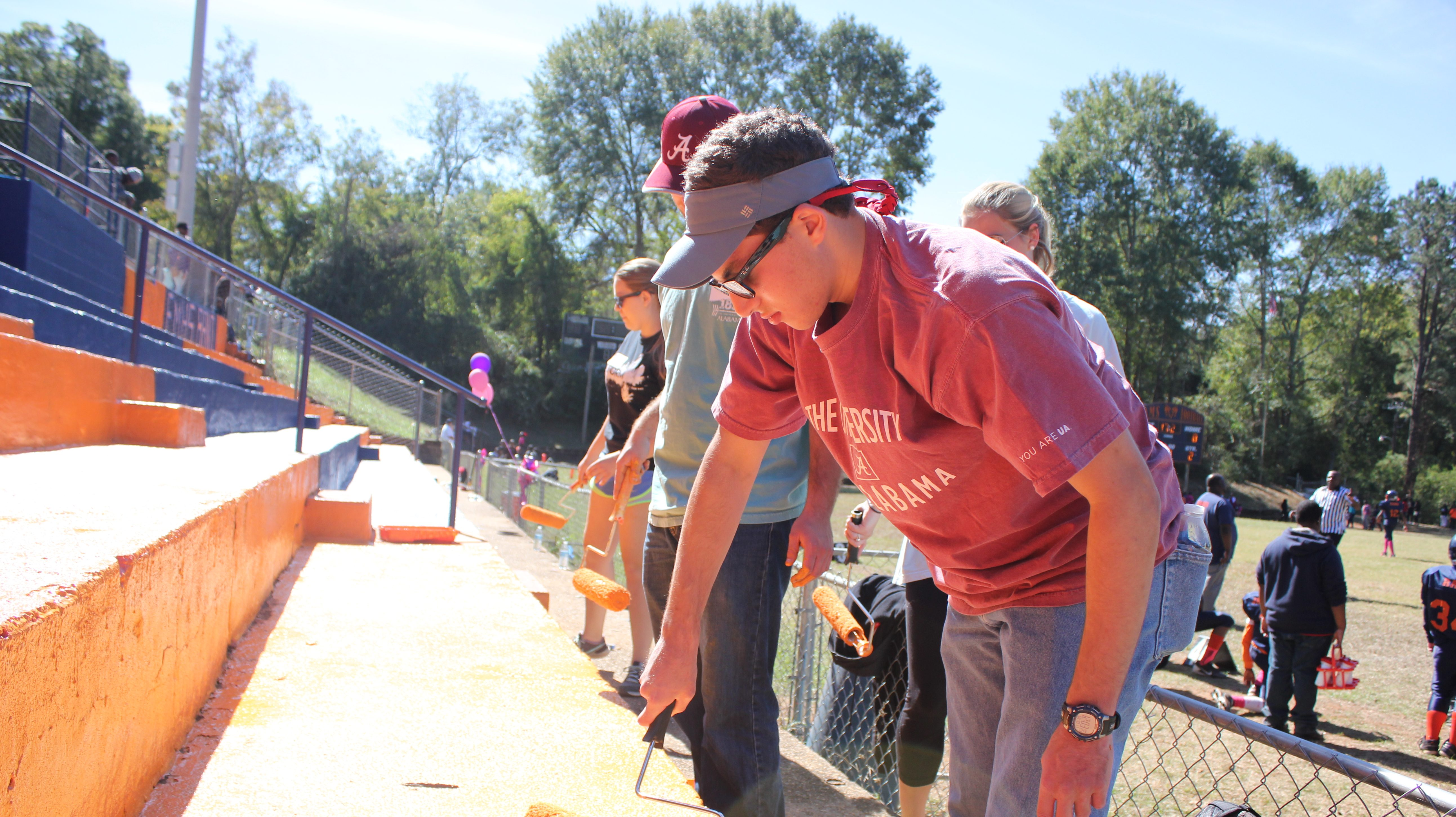 Story Image - Students painting bleachers